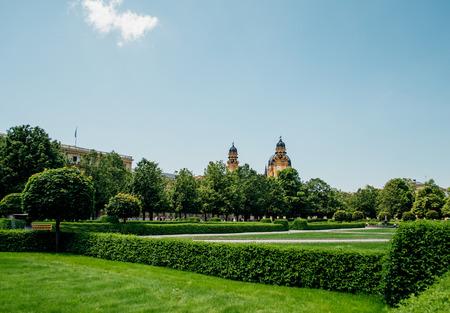 residenz: Hofgarten - Court Garden - is a garden in the center of Munich, Germany, located between the Residenz and the Englischer Garten. Clear sky and perfect green german meadows Editorial