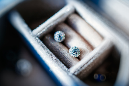 Diamond crystal earrings in luxury storage box - beautiful jewelry - tilt-shift lens used to outline the object and to emphasize the attention on them photo