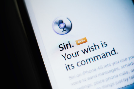 CUPERTINO, UNITED STATES - FEBRUARY 11, 2012: Siri the intelligent personal assistant and knowledge navigator button as seen on Apple iPhone on February 11, 2012. Siri was originally introduced as an iOS application available in the App Store by Siri, Inc Editoriali