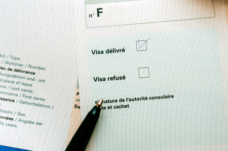 visa approved: Visa approved marked with pen on french language application form Stock Photo