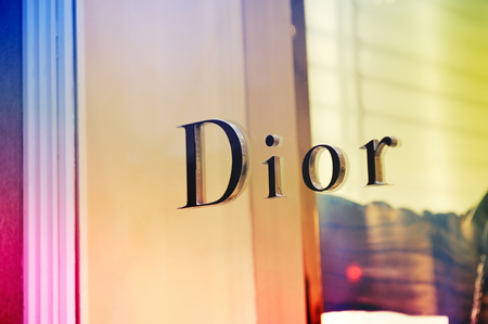 FLORENCE, ITALY - APRIL 16, 2012: Dior logo on flagship store in the Piazza degli Strozzi, luxury shopping street in Florence on April 16, 2012. Dio, is a French luxury goods company controlled and chaired by businessman Bernard Arnault who also heads LVM