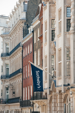 LONDON, UNITED KINGDOM - AUGUST 28, 2013: Sotheby's flag above London Office on New Bond Street on August 28, 2013. Sotheby's is one of the world's largest brokers of fine and decorative art, jewelry, real estate and collectibles Editorial