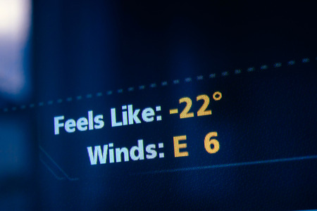 weather map: Current weather display interface on a modern digital display showing cold weather  Tilt-shift lens used to outline the cold -22 symbols
