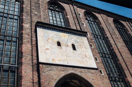 Sun clock - ancient vintage painted form on the facade of Munich Cathedral, Germany photo