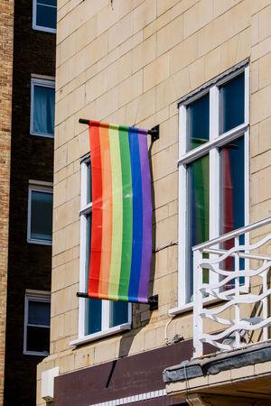 castro: Rainbow flag - gay symbol - as seen on apartment window Stock Photo