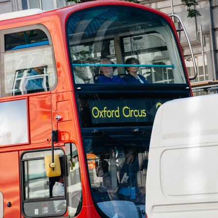 unrecognisable: London Bus going to Oxford Circus - typical London transportation mode. Short depth of field and unrecognisable persons onboard