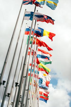 belgique: European country flags in Brussels on European commission site - European Union Parliament, tilt shift focus Stock Photo