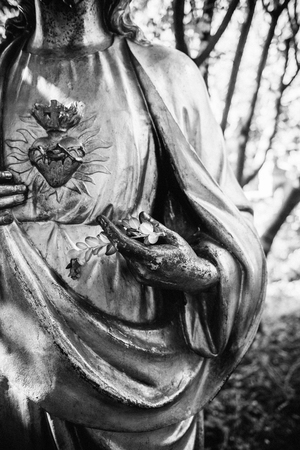clearer: Jesus Christ statue holding olive branch. Black and white photograph to depict a clearer religious message