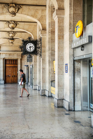 collectivity: PARIS, FRANCE - AUGUST 18, 2014: Main entrace to postal office of La Poste in Paris, France. La Poste is the mail service of France, which also operates postal services in the French Overseas Departments and the territorial collectivity of Saint Pierre an