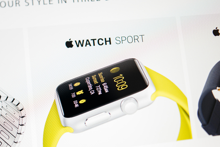 anodized: PARIS, FRANCE - September 10, 2014: Apple Computers website close up details with the newly launched Apple Watch Sport wearable technologies as seen on 10 September, 2014. It features anodized aluminum cases in silver or space gray, strengthened Ion-X gla