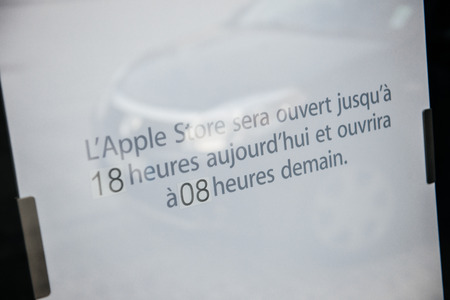 STRASBOURG, FRANCE - SEPTEMBER 18, 2014: Apple Store with covered front shopping-windows and unusual schedule announce due to iPhone launch on September 18, 2014. Apples redesigned iPhones with bigger screens goes on sale in US, Europe and Asia on Sept.  Editorial