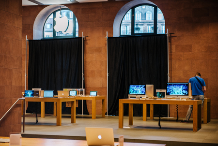 rearrangement: STRASBOURG, FRANCE - SEPTEMBER 18, 2014: Apple Store with working Apple Genius Employee and covered shopping windows with black fabric curtains to protect the store rearrangement for the iPhone 6 launch. Apples redesigned iPhones with bigger screens goes Editorial