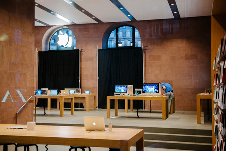 STRASBOURG, FRANCE - SEPTEMBER 18, 2014: Apple Store with working Apple Genius Employee and covered shopping windows with black fabric curtains to protect the store rearrangement for the iPhone 6 launch. Apples redesigned iPhones with bigger screens goes Editorial