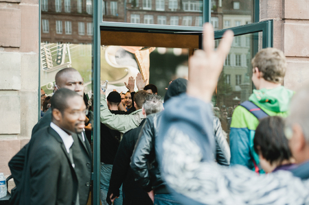 manufacturer: STRASBOURG, FRANCE - SEPTEMBER 19, 2014: First customers entering Apple Store for the new iPhone 6 launch while employees give high-fives as they enter the Apple Inc.. The new iPhone iPhone 6 and iPhone 6 Plus starts selling in worldwide on Friday, Septem