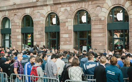STRASBOURG, FRANCE - SEPTEMBER 19, 2014: Customers wait in line outside the Apple Inc. store during the sales launch of the iPhone 6 and iPhone 6 Plus in Europe, on Friday, Sept. 19, 2014. Apple stores attracted long lines of fans and shoppers for the deb