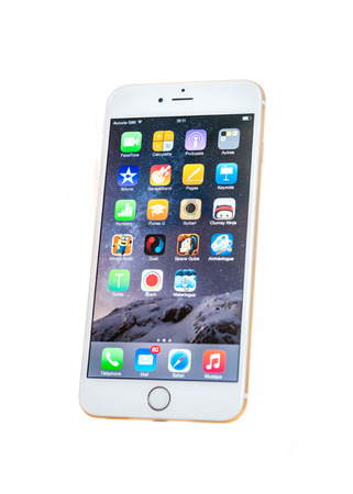 PARIS, FRANCE - SEPTEMBER 20, 2014: New iPhone 6 Plus isolated on white background. New Apple iPhone tends to become one of the most popular smart phones in the world.