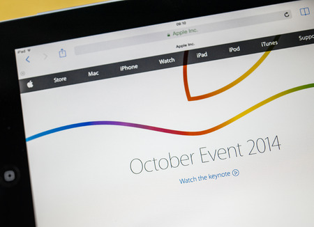 PARIS, FRANCE - 17 OCTOBER 2014: Photo of Apple iPad tablet with apple.com webpage October event. Apple unveiled the new iPad Air 2 and iPad Mini 3, iMac with 5K Retina display and the new Mac Mini