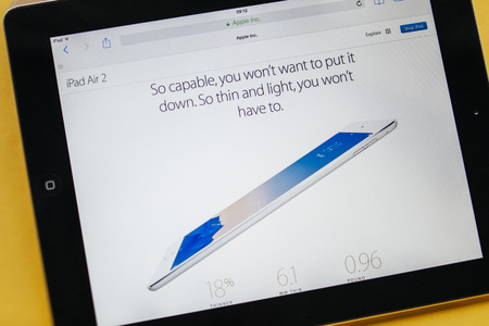 retina display: PARIS, FRANCE - 17 OCTOBER 2014: Photo of Apple iPad tablet with apple.com webpage. Apple unveiled the new iPad Air 2 and iPad Mini 3, iMac with 5K Retina display and the new Mac Mini Editorial