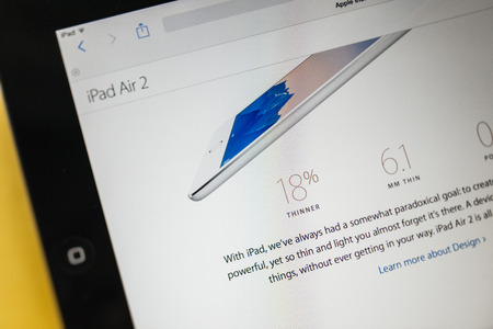 PARIS, FRANCE - 17 OCTOBER 2014: Photo of Apple iPad tablet with apple.com webpage of the new iPad Air 2 and iPad Mini 3 new specs. Apple unveiled the new iMac iPad Air 2 and iPad Mini 3 on 16 Oct