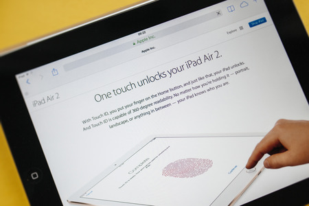 PARIS, FRANCE - 17 OCTOBER 2014: Photo of Apple iPad tablet with apple.com webpage of the new iPad Air 2 and iPad Mini 3touch id. Apple unveiled the new iMac iPad Air 2 and iPad Mini 3 on 16 Oct