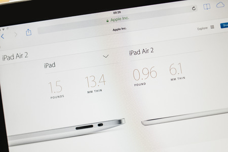 PARIS, FRANCE - 17 OCTOBER 2014: Photo of Apple iPad tablet with apple.com webpage of the new iPad Air 2 and iPad Mini 3 dimenssions. Apple unveiled the new iMac iPad Air 2 and iPad Mini 3 on 16 Oct