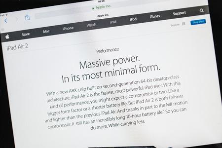 PARIS, FRANCE - 17 OCTOBER 2014: Photo of Apple iPad tablet with apple.com webpage of the new iPad Air 2 and iPad Mini 3 slogan. Apple unveiled the new iMac iPad Air 2 and iPad Mini 3 on 16 Oct