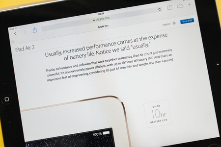 PARIS, FRANCE - 17 OCTOBER 2014: Photo of Apple iPad tablet with apple.com webpage of the new iPad Air 2 and iPad Mini 3 battery life. Apple unveiled the new iMac iPad Air 2 and iPad Mini 3 on 16 Oct