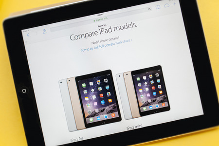 PARIS, FRANCE - 17 OCTOBER 2014: Photo of Apple iPad tablet with apple.com webpage of the new iPad Air 2 and iPad Mini 3. Apple unveiled the new iMac iPad Air 2 and iPad Mini 3 on 16 Oct