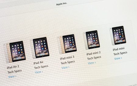 retina display: PARIS, FRANCE - 17 OCTOBER 2014: Photo of Apple iPad tablet with apple.com webpage of the new iPad Air 2 and iPad Mini range and prices. Apple unveiled the new iMac iPad Air 2 and iPad Mini 3 on 16 Oct
