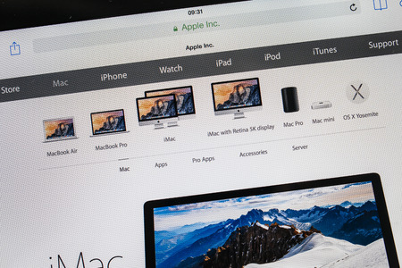 retina display: PARIS, FRANCE - 17 OCTOBER 2014: Photo of Apple iPad tablet with apple.com webpage of the new iMac 5k. Apple unveiled the new iPad Air 2 and iPad Mini 3, iMac with 5K Retina display and the new Mac Mini