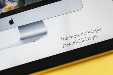 PARIS, FRANCE - 17 OCTOBER 2014: Photo of Apple iPad tablet with apple.com webpage of the new iMac 5k showing its launching slogan. Apple unveiled the new iMac with 5K Retina display on 16 October