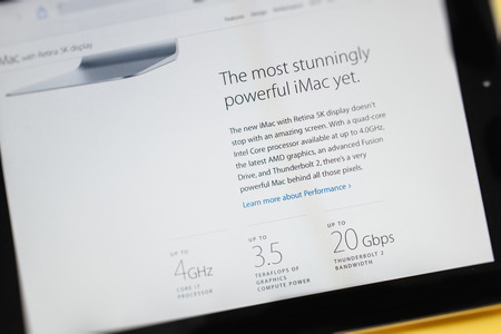 retina display: PARIS, FRANCE - 17 OCTOBER 2014: Photo of Apple iPad tablet with apple.com webpage of the new iMac 5k showing its performance specs. Apple unveiled the new iMac with 5K Retina display on 16 October