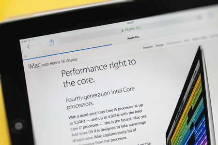 PARIS, FRANCE - 17 OCTOBER 2014: Photo of Apple iPad tablet with apple.com webpage of the new iMac 5k showing its sIntel Core CPU specs. Apple unveiled the new iMac with 5K Retina display on 16 October