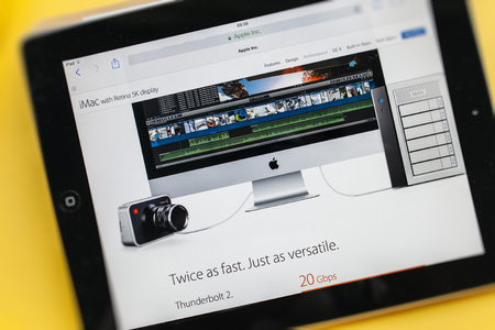 retina display: PARIS, FRANCE - 17 OCTOBER 2014: Photo of Apple iPad tablet with apple.com webpage of the new iMac 5k showing its connectivity ports for videographers. Apple unveiled the new iMac with 5K Retina display on 16 October Editorial
