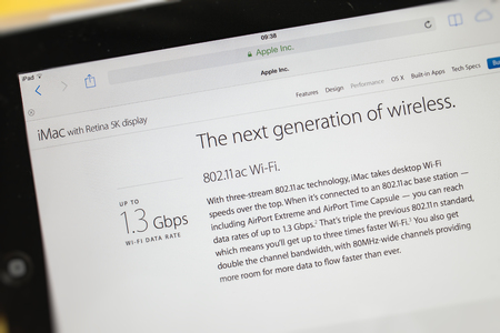 PARIS, FRANCE - 17 OCTOBER 2014: Photo of Apple iPad tablet with apple.com webpage of the new iMac 5k showing its Wi-Fi speed. Apple unveiled the new iMac with 5K Retina display on 16 October