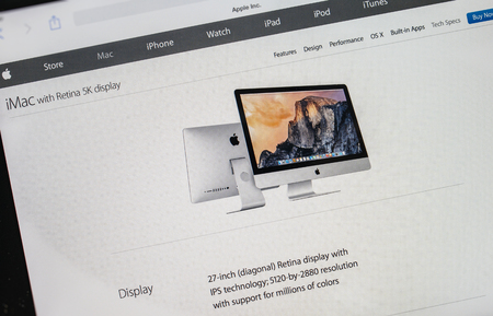 display retina: PARIS, FRANCE - 17 OCTOBER 2014: Photo of Apple iPad tablet with apple.com webpage of the new iMac 5k showing its 21 inch and 27 inch iMac. Apple unveiled the new iMac with 5K Retina display on 16 October