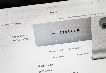 retina display: PARIS, FRANCE - 17 OCTOBER 2014: Photo of Apple iPad tablet with apple.com webpage of the new iMac 5k showing its connectivity ports. Apple unveiled the new iMac with 5K Retina display on 16 October