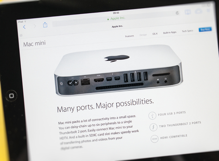 PARIS, FRANCE - 17 OCTOBER 2014: Photo of Apple iPad tablet with apple.com webpage of the new Mac Mini. Apple unveiled the new iPad Air 2 and iPad Mini 3, iMac with 5K Retina display and the new Mac Mini