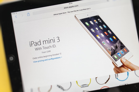 PARIS, FRANCE - 17 OCTOBER 2014: Photo of Apple iPad tablet with apple.com webpage of the new Apple unveiled the new iPad Air 2 and iPad Mini 3, iMac with 5K Retina display and the new Mac Mini