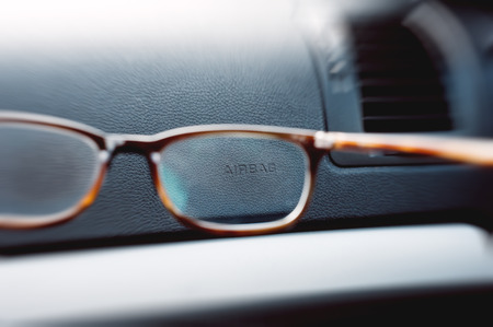 Airbag sign seen through a pair of glasses photo