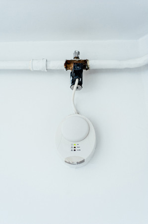 Gas carbon monoxide detector on a wall. Carbon monoxide (CO) is a colorless, odorless gas that can lead to carbon monoxide poisoning, a type of asphyxiation. Household gas boilers that are working incorrectly may produce high levels of CO.