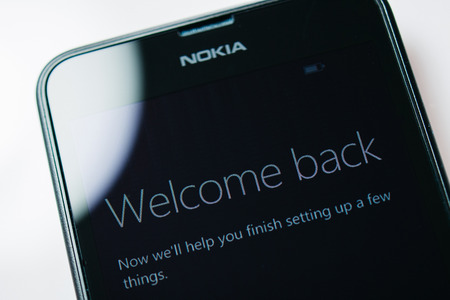 internet explorer: LONDON, UNITED KINGDOM - NOVEMBER 9, 2014: Nokia Lumia Windowsphone smartphone display with Welcome Back text. Microsoft has announced that it will stop using Nokia branding on all future mobile phones