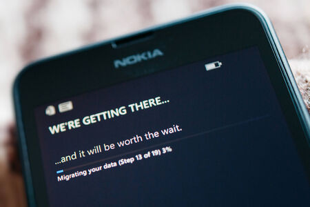 internet explorer: LONDON, UNITED KINGDOM - NOVEMBER 9, 2014: Nokia Lumia smartphone first run with message Were Getting There on the screen. Microsoft has announced that it will stop using Nokia branding on all future mobile phones Editorial