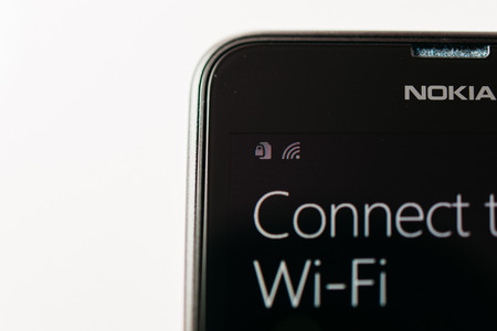 internet explorer: LONDON, UNITED KINGDOM - NOVEMBER 9, 2014: Nokia Lumia smartphone windowsphone with Connect to Wi-Fi message on display. Microsoft has announced that it will stop using Nokia branding on all future mobile phones