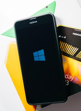 LONDON, UNITED KINGDOM - NOVEMBER 9, 2014: Nokia Lumia Microsoft Windowsphone smartphone with Windowsphone logo on screen. Microsoft has announced that it will stop using Nokia branding on all future mobile phones