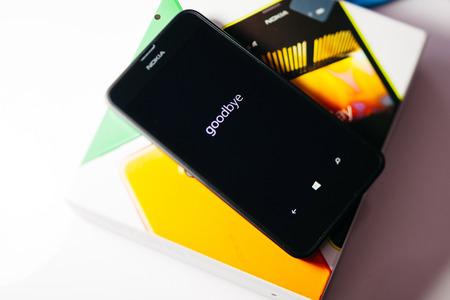 internet explorer: LONDON, UNITED KINGDOM - NOVEMBER 9, 2014: Nokia Lumia Windowsphone smartphone - goodbye text on phone screen. Microsoft has announced that it will stop using Nokia branding on all future mobile phones