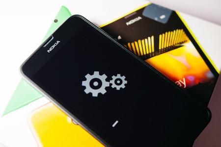 internet explorer: LONDON, UNITED KINGDOM - NOVEMBER 9, 2014: Nokia Lumia windowsphone smartphone - installation process on touchscreen. Microsoft has announced that it will stop using Nokia branding on all future mobile phones