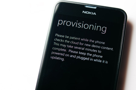 internet explorer: LONDON, UNITED KINGDOM - NOVEMBER 9, 2014: Nokia Lumia smartphone windowsphone with Provisioning message on screen. Microsoft has announced that it will stop using Nokia branding on all future mobile phones Editorial