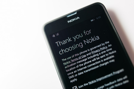 internet explorer: LONDON, UNITED KINGDOM - NOVEMBER 9, 2014: Nokia Lumia smartphone windowsphone with Thank you for choosing Nokia. Microsoft has announced that it will stop using Nokia branding on all future mobile phones