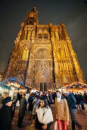 cathedrale: STRASBOURG, FRANCE - DEC 5, 2014: Place de la Cathedrale during Christmas Market in Strasbourg. Strasbourg is considered the most picturesque experience of Christmas spirit and one of the oldest Christmas Market in Europe attracting over 2 million visitor